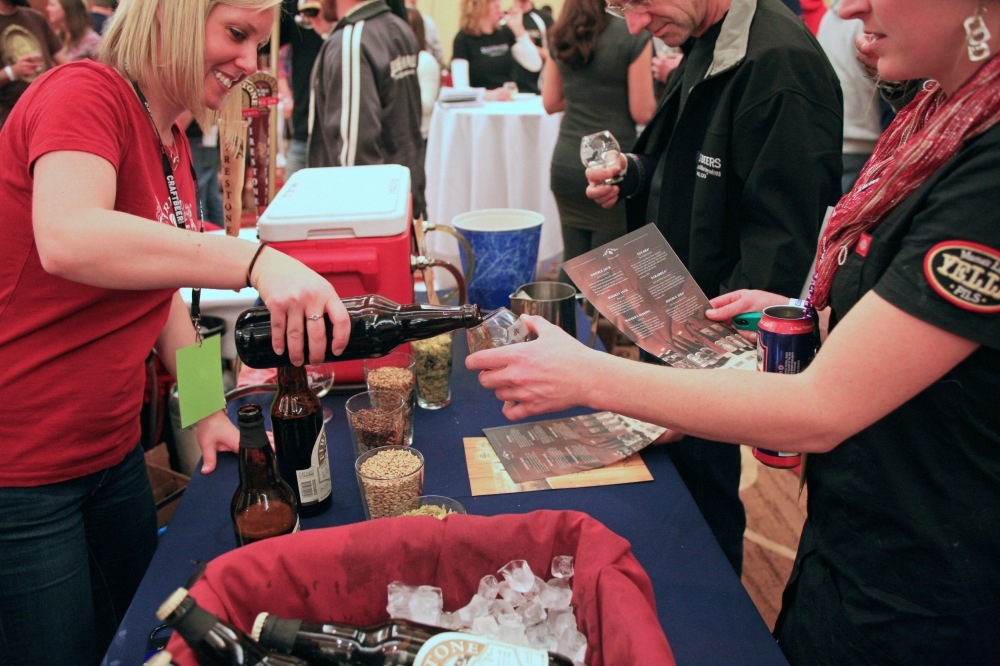 Elizabeth from Firestone Walker pouring a sample of Wookey Jack for an attendee at the Commercial Tasting (from Big Beers, Belgians, & Barleywine site)