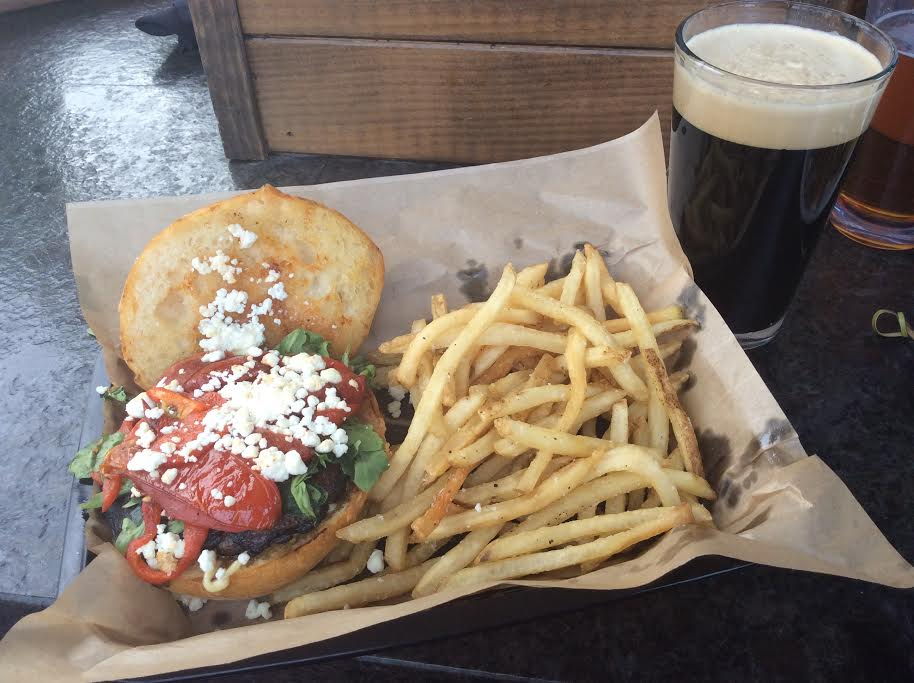 Fun Guy Burger: grilled portabello patty topped with goat cheese, arugula, roasted tomatoes, & garlic mayo