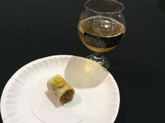 Vegan barley sausage wrapped in a buttermilk biscuit, served with spicy mustard by WaterCourse Foods, with Fruhling, Zwickel Maibock from Renegade Brewing