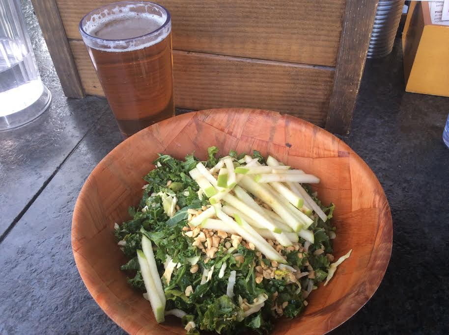 Kale Salad with julienned cabbage, green apple, cilantro, scallions, roasted peanut vinaigrette, and fresh peanuts.