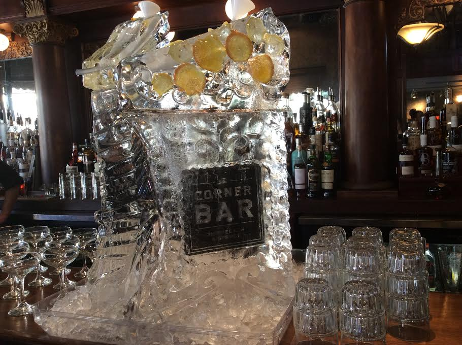 Ice sculpture, complete with tube for pouring cocktails