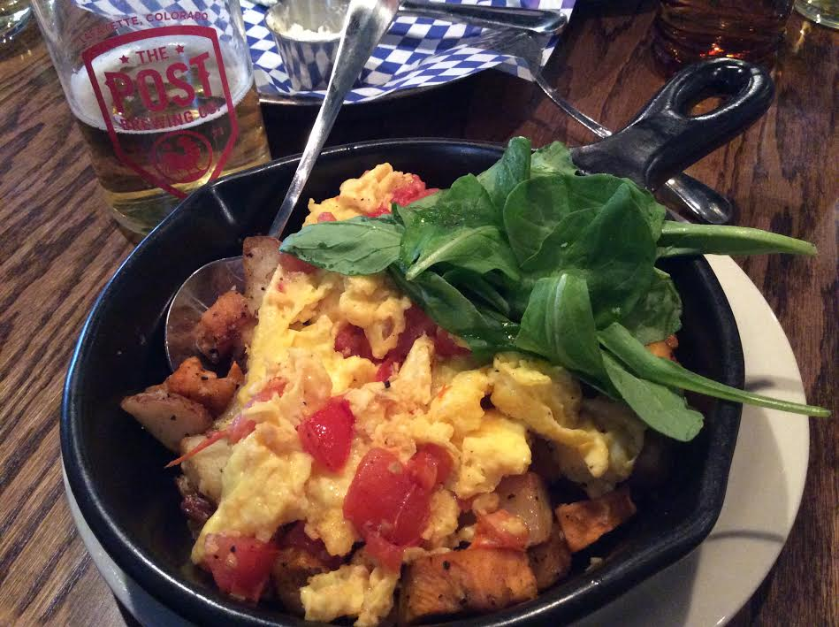 Vegetable Hash Scramble: eggs, roasted tomato, root vegetables, arugula. With a Howdy Beer (Pilsner).