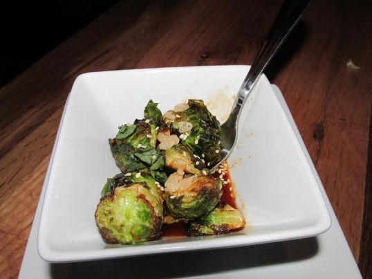 Crispy Brussels: Mint, cilantro, truffle-chili glaze, snap, crackle, pop.