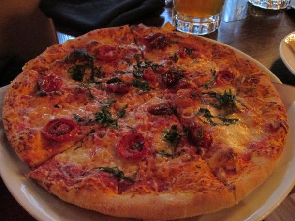 Margherita Pizza: cherry tomatoes, basil, and San Marzano tomato