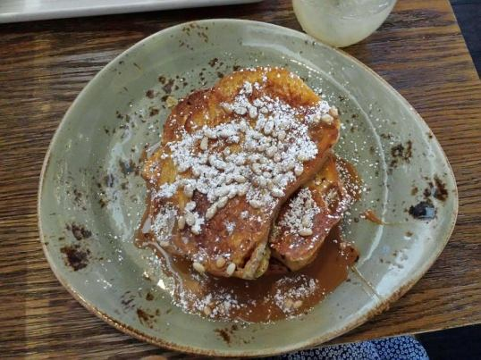 Pinon Crusted French Toast: cajeta caramel, whipped cream, and toasted pinon nuts