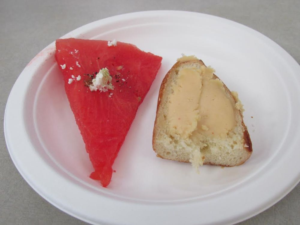 Beer cheese on a pretzel roll with a slice of watermelon with feta from New World Cheese.