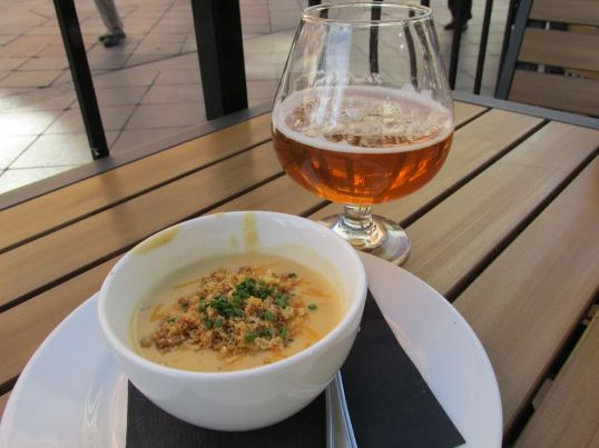 A cup of Henry's Beer Cheddar Soup