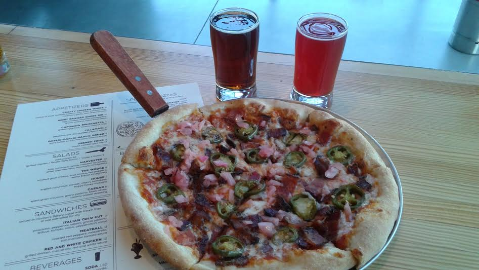 Baconator Pizza: Tender Belly bacon 3-ways: hop sugar bacon, pepper bacon, herb bacon, sour onions, jalapeños, red sauce.
