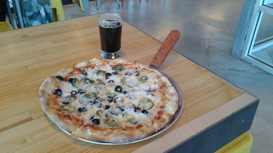 Build Your Own Pizza with black olives, jalapeños and Swiss cheese